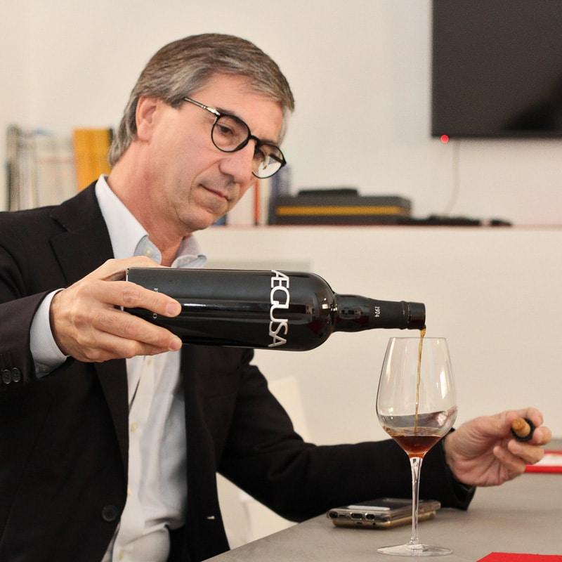 Luigi Salvo pouring wine